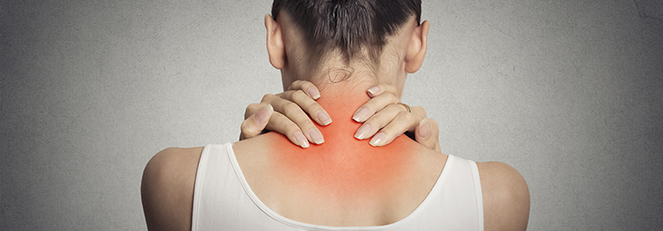 Healthy lifestyle. Back and spine disease. Closeup back view tired female massaging her neck colored in red isolated on gray background
